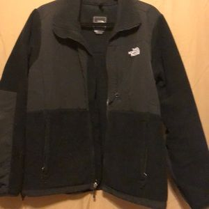 North face jacket. Black zippered pockets